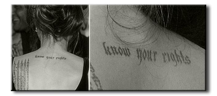 """Джоли, Анджелина - татуировка """"Знай свои права"""""""